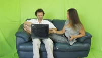 Couple with a laptop and a smartphone on the sofa绿布抠像素材