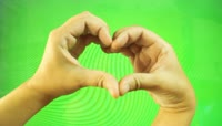 Hands form heart shape, namaste gesture on green screen绿布抠像素材